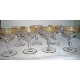 7 gilded champagnes or sherbets with wreaths and bows
