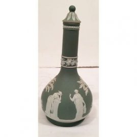 Green Wedgwood liquor bottle, manufactured for Humphrey Taylor &Co., London, 1770 by Wedgwood Height 9 inches, bulbous width 4 1/2 inches, Before 1890, Sold.