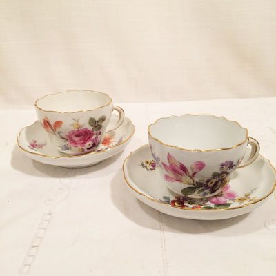 Set of 10 Meissen cups and saucers each painted with different flower bouquets.