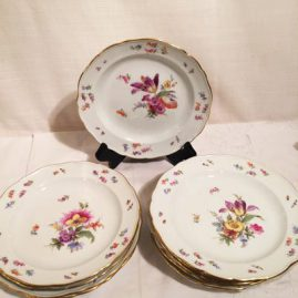 Set of ten Meissen dessert plates, each painted with different flower bouquets and bugs. Circa-1880s-1890s. Diameter-8 1/8 inches. Price on Request.