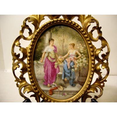 Porcelain plaque artist signed Wagner in Venetian frame of two ladies in a garden,