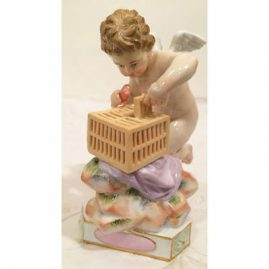 Meissen cherub figure of cherub putting heart in cage, titled je le captive. Circa- 1880s, Height- 5 inches tall and 3 1/2 inches wide. Price on Request.
