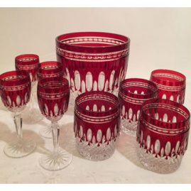 Signed Waterford ruby stemware which includes four ports-6 inches tall, four lowboys or scotch glasses-4 inches tall, and an ice bucket-circumference 7 inches, height 7 1/2 inches. Prices on Request
