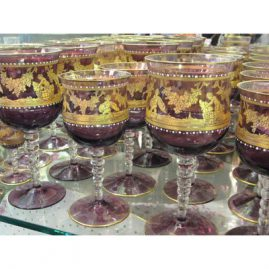 Large set of amethyst Salviati stemware with white enamel jeweling and painted with gilt cherubs at harvest time.This set includes ten goblets-7 inches tall, eight white wine goblets-6 inches tall, seven champagnes-5 6/8 inches tall and 5 cordials-3 5/8 and 5 larger cordials-4 3/8 inches..Price on Request.