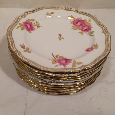 Set of eleven Spode made for Tiffany fluted dessert plates with beautiful pink roses with a white back ground