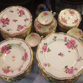 Spode made exclusively for Tiffany rose dinner service. Dinner set includes 14 dinner plates, 12 wide rim soups, 13 desserts or luncheon plates, 13 bread plates and eight tea cups and saucers. Price on Request.
