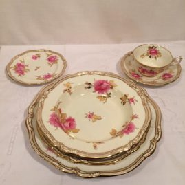 Rare Spode made for Tiffany dinner service with beautiful pink roses, 14 dinner plates-10 3/4 inches, 12 wide rim soup bowls-8 3/4 inches, 13 salad or luncheon plates- 9 inches, a3 bread plates-6 inches and 8 cups and saucers. Price on Request