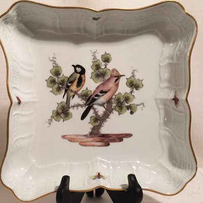 Meissen bowl painted with birds and bugs.