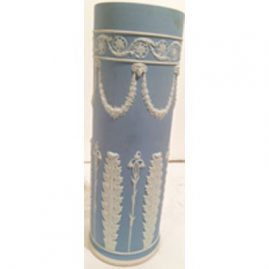 Wedgwood tall vase before 1890s, with lilies of the valley and rams heads. Height is 12 inches. Sold.