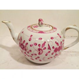 Meissen purple Indian teapot with rose on top, 9 1/2 inches wide, 6 inches tall.  Sold