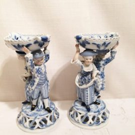 Pair of Meissen blue onion figural master salt cellars of a lady and a man, each piece has reticulated tops and bottoms. Circa-1870s-1880s.  7 5/8 inches tall, length-6 inches and depth 3 3/4 inches. Price on Request