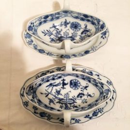 Two Meissen blue onion gravies with attached under plates. One of them  is from 1890s-1920 and the other is from 1923-1933. Length-9 inches, 6 1/2 inches deep, and 3 1/2 inches tall. Price on Request.