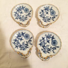 Seven Meissen blue onion handled servers. Late 19th century. Length 5 1/4 inches, width-4 3/8 inches. Prices on Request.