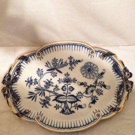 Wonderful rare Meissen blue onion tray with bows and gold rim. Circa-1890s-1920. Length-16 inches and height-11 1/2 inches. Price on Request.
