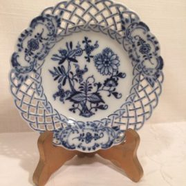 Set of twelve Meissen blue onion reticulated appetizer plates. Diameter is 6 inches. Price on Request.