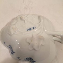 This is the interesting bottom of the Meissen blue onion leaf bowls. Prices on Request.