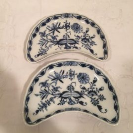 Set of twelve Meissen blue onion large crescent shaped dishes. Circa-1923-1933. Eight inches wide by 5 inches tall. Price on Request.