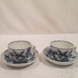 Twelve Meissen blue onion demitasse cups and saucers
