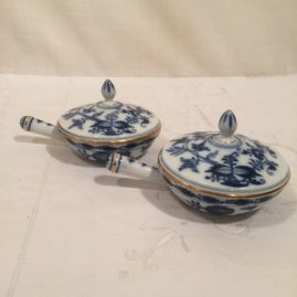 Set of 12 rare Meissen blue onion sauciers or pot de cremes with gilded border. Before 1890s. Six inches long by 3 1/2 inches tall. Price on Request