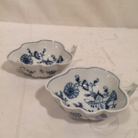 Six unusual Meissen blue onion leaf bowls.  Circa-1890s. Length-4 3/4 inches by 3 1/2 inches tall. Price on Request.