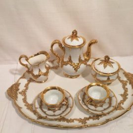 Beautiful Meissen white with heavy gold coffee set with tray. The set includes a coffee pot, covered sugar and creamer with two cups and saucers with a large tray.  Length of tray-19 inches, depth of tray-13 1/2 inches. Circa-1880s. Sold.