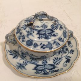 Meissen blue onion ecruelle with matching  under plate and gilded borders. Width-7 1/2 inches by 6 inches tall. Price on Request.