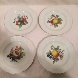 Meissen dessert plates with fruit paintings, each plate painted with different fruits and each having raised shell borders. Circa-1870s. Diameter-7 1/4 inches. Sold.