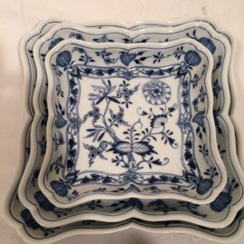 Nest of three square blue onion Meissen bowls. Circa-1890s. Diagonal measurements of each bowl- 8 1/2 inches, 11 inches and 12 inches. Prices on Request