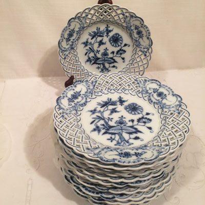 Set of twelve Meissen blue onion reticulated luncheons.