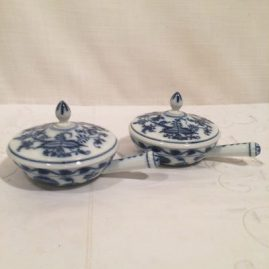 Set of 12 Meissen blue onion sauciers or pot de cremes. 6 inches long by 3 1/2 inches tall. Circa-1890s. Price on Request.