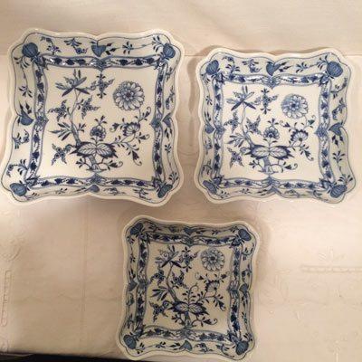 Three Meissen blue onion square bowls.