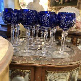 Set of twelve Bohemia Czechoslovakian goblets with cut stems.