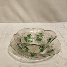 Rare set of Venetian bowls and under plates with raised grape and vine decoration. We have eight bowls and six under plates. All pieces have raised grape and vine decoration. Prices on Request.