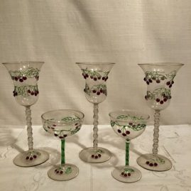 Set of twelve rare Venetian goblets and set of eight ports with raised cherries and stems. Goblets are 7 7/8 inches tall and ports are 4 3/8 inches tall. Prices on Request