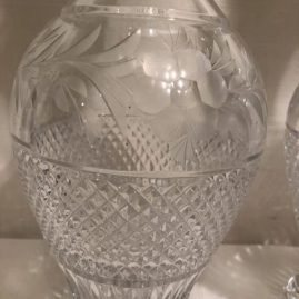 Close up of the pair of tall cut and wheel cut crystal tall decanters.