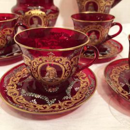 Close up of a Venetian set with each piece with a different painted portrait. This set includes four cups and saucers, a covered sugar, 6 inches tall and a creamer, 5 inches tall. Price on Request.