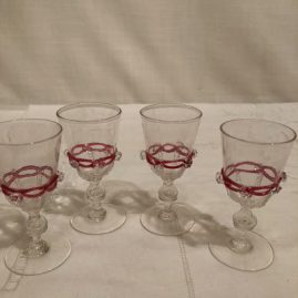 Set of five Salviati Venetian cordials with applied pink ribbon and raised crystal balls . Height- 3 7/8  inches. Price on Request.