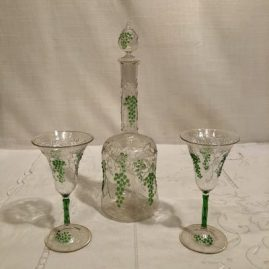 Rare Venetian decanter and cordials with raised grape and vine decoration. The decanter is 10 inches tall. We have two sets of cordials. One is a set of six cordials that are 4 3/4 inches tall and the other set of five cordials is 5 1/4 inches tall. Prices on Request.