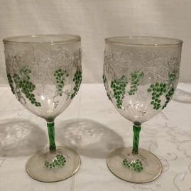 Rare set of four Venetian goblets with raised grapes and vines. They are 6 1/2 inches tall. We have two other similar ones you can use with these four to make a set of six. Prices on Request.