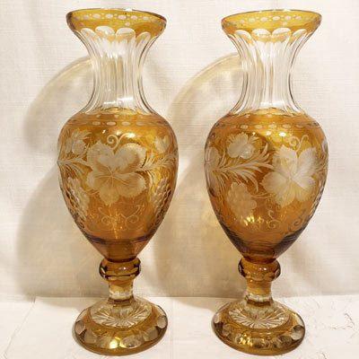Pair of tall gold Bohemia Czechoslavakia overlay wheel cut vases.