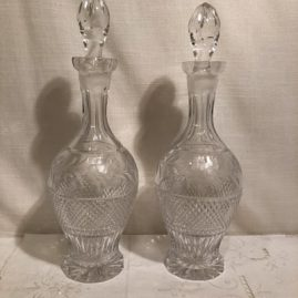 Pair of tall cut and wheel cut crystal tall decanters. Height of decanter is 15 inches. Price on Request.