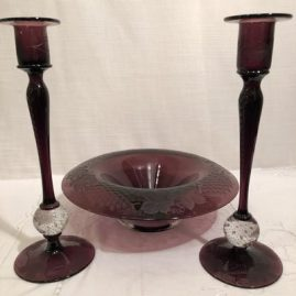 Pairpoint amethyst wheel cut console set with pair of candlesticks and bowl.