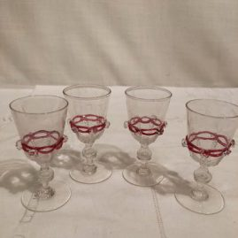 Set of four Salviati Venetian cordials with applied pink ribbon and raised crystal balls . Height- 3 1/4 inches. Price on Request.