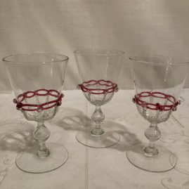 Set of eight Salviati Venetian White wines with raised pink ribbon glass decoration and applied crystal balls. Height is 6 inches tall. Price on Request.