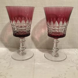 Set of eleven cranberry Val Saint Lambert crystal overlay goblets. Height is 6 1/8 inches. Price on Request.
