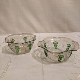 Another view of two of the set of eight Venetian bowls with the raised grape and vine decoration