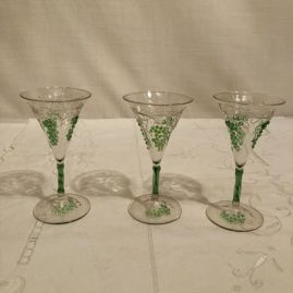 Set of six rare Venetian cordials with raised grape and vine decoration. Height of cordial is 4 3/4 inches tall. Prices on Request.