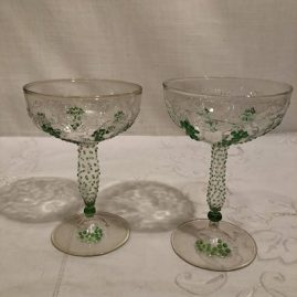 Pair of rare Venetian hollow stem champagnes with raised grape and vine decoration.  Height is 5 1/2 inches. Price on Request