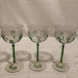 Set of eight rare Venetian white wines with raised grape and vine decoration. each wine is 6 inches tall. Price on Request.