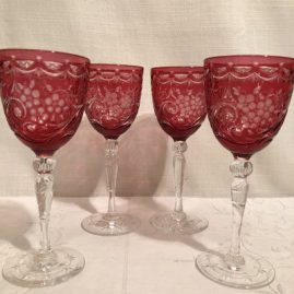 Four beautifully cut Webb crystal wines. Height-6 3/4 inches. Price on Request.